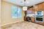 Large Breakfast Nook with Wall Oven and Microwave and Desk Area.