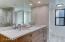 Hall Bath has dual sinks.