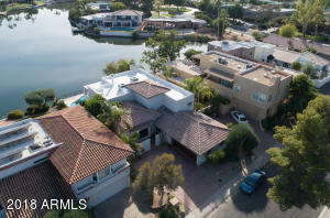 Enjoy resort-style, waterfront living from a protected cove on Lake Viento in McCormick Ranch!