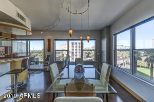 Completely updated architect's residence featuring: beautiful mountain & city views, stained concrete floors throughout, in-unit washer/dryer, HUGE walk-in shower in master bath, new windows, Ceasarstone countertops in kitchen, two assigned parking spots in the underground garage & much more!. Building features in the historic Phoenix Towers include: 24/7 door staff, close proximity to the Encanto light rail station, two spectacular rooftop terraces (one enclosed, one open-air) with 360 degree views available for private entertaining. Commercial grade central plant HVAC system, all-concrete construction, resort sized heated saltwater lap pool with adjacent kitchen, gym, community garden and dog park. Monthly fee covers everything --all utility costs, cable, and even real estate taxes!