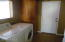 Large laundry with storage and washer and dryer