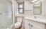Master bath is a walk in shower with unique angled cabinets.