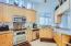 Granite Kitchen/ Stainless Appliances.