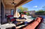 The expansive patio has multiple sitting and entertaining areas.
