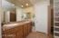 Double sinks, walk-in closet, private water closet, separate shower and tub all add to the functionality of the master bath.