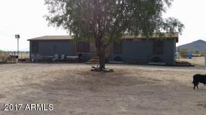 front parking area with shade tree