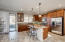 upgraded cabinets, granite counters, detailed island