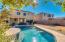spacious backyard with sparkling pool