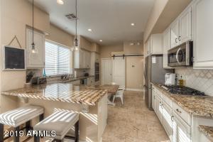 Beautiful cabinetry, granite slab countertops, stunning backsplash!