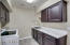 Remodeled Laundry Room w/ Marble Countertops and Wood-Plank Tile