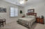Plantation shutters add privacy and style to the guest bedroom.