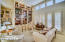 Stunning built in Library with Sliding Ladder.. French Drs open to spacious covered back patio.