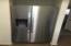 New stainless steel refrigerator with ice and water in door.