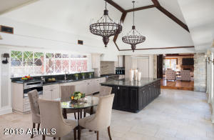 A dream kitchen. Viking appliances, labradorite counter surfaces, indoor and outdoor dining areas.
