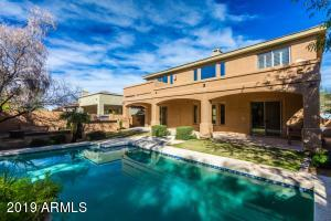 Ready for SUMMERTIME! Huge Covered Patio, Pebble Tech SALT WATER Pool, Turn on the Water Features, Light up the Grill and Let's Get this Party Started!