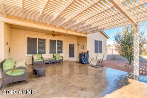 Relaxing shaded patio. Furniture for sale outside of home purchase.