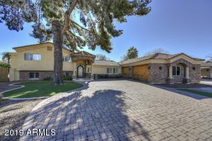 BEAUTIFUL HOME W/DET. GUEST HOUSE & HORSE STALLS ON MASSIVE LOT MINUTES FROM SCOTTSDALE FASHION SQUARE & OLD TOWN SCOTTSDALE. NO HOA! Don't miss this beautiful 5B/3.5B, 3-car garage home sitting on a 28,000 sqft lot! The 2,971 sqft main home features a tri-level floorpan starting with a great room, bedroom, bath and gaming room on the lower level. The main level includes the kitchen, family room, dining area, laundry and guest room with attached bath. The 3rd level presents the master with master bath and massive walk-in closet, 2 additional bedrooms and a full bath. Venture outside to enjoy your large diving pool, 2-stall horse stable and a 728 sqft detached guest house/rec room. You don't want to miss this beautiful home, only minutes from Scottsdale Fashion Square, Old Town and 101.