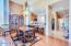 Great Room dining, built-in desk in hallway. Laminate & tumbled travertine flooring.