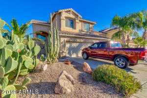 Lovely 2 story with 3 car garage and easy care desert landscaping!