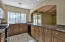 Spacious Kitchen with Granite Slab Counters