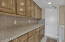 Spacious Inside Laundry Room with Lots of Cabinets and Storage Space