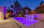 The Sheer Descent water feature provides tranquility to night time outdoors.