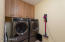 Lots of space for storage in laundry room with floor to ceiling cabinets!!