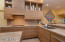 Beautiful White Oak custom cabinetry is continued throughout the home.
