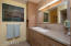Spacious guest bath with granite countertops and Hansgrohe fixtures.