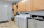 Amazing Laundry with space for a second fridge/freezer, sink, hanging bar, built-in ironing board and plenty of cabinets