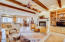 Gas Fire Place, Stone Flooring, and Wood Beams create Warm, Rich atmosphere in your Family Rm