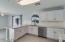 Quartz counters, SS appliances, Gas stove, Under cabinet lighting, Pantry.