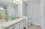 Quartz countertops, double sinks, storage closet, new toilet.