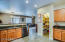 Large walk-in pantry with extra storage under stairway