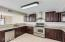 Ample Countertop space and cabinets. Convenient Inside laundry room