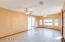 Great Room is 21'x 11' and a features a bay window and door.