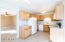 Spacious eat-in kitchen features upgraded cabinets and white appliances.