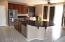 Island with sink & granite counter top.