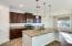 Walk in panty upgraded cabinets and custom lighting throughout kitchen area