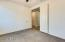 Office/Den with Sealed and polished concrete floors and Bose in-ceiling speakers