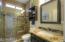 Custom first floor full bathroom. Granite counter tops, custom glass shower door and all tile shower