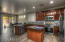 amazing open kitchen with custom under cabinet lighting, all tile back splash, oversize island