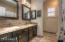 full bathroom with custom tile work, granite counter tops, and custom mirrors