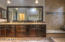 double sinks custom tile work, granite counter tops, storage