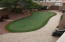 Every inch of the yard has a feature - check out the putting green, children's play house and swing area