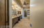 Travertine floors, slab granite dual sink vanity - custom cabinets with hidden storage