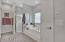 Pristine master bathroom makes getting ready in the morning a breeze.