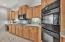 Kitchen features top of line appliances - Frigidaire and LG; double ovens, microwave & gas cooktop
