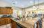 Kitchen featuring granite countertops, upgraded cabinetry, RO system and stainless steel appliances