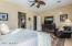 Spacious master suite with sitting area, double sinks, walk in shower and his and hers closets.
